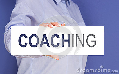 Woman with coaching sign