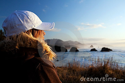 Woman at coast overlooking ocean