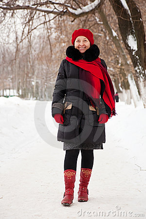Woman in coat and red cap