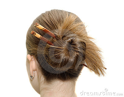 Woman coiffure with asian sticks