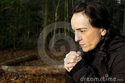 Woman cold in woods