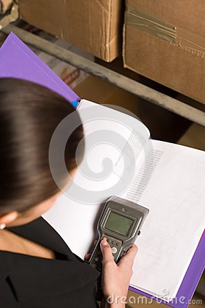 Woman collecting data via data terminal equipment