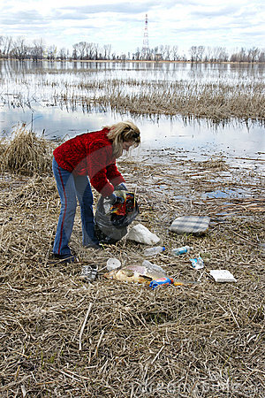 Woman collecting rubbish in nature