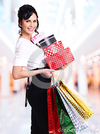 Woman with color shopping bags and boxes.