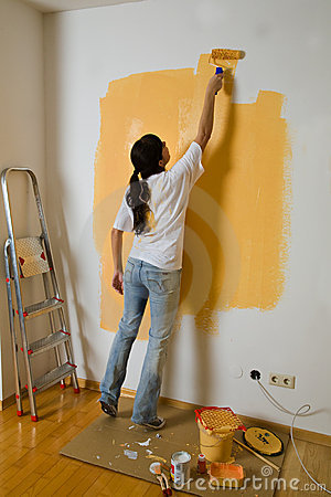 Free Woman Colours Her Apartment Stock Images - 4633234