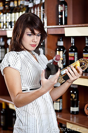 Woman  comparing two wines
