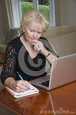 Free Woman Completing A Crossword Puzzle Stock Images - 57019344