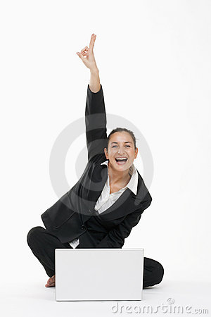 Woman with computer cheering