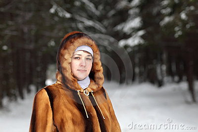 Woman in coniferous forest