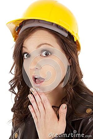 Woman construction hat shock