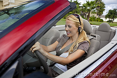 Woman In Convertible Car on Bluetooth Headset