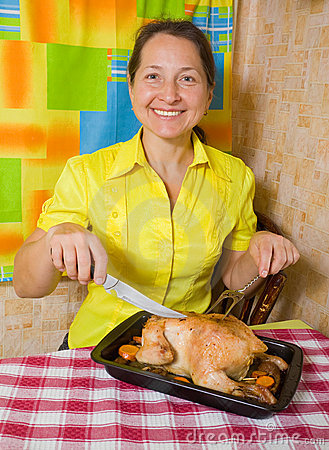 Woman with cooked  chicken