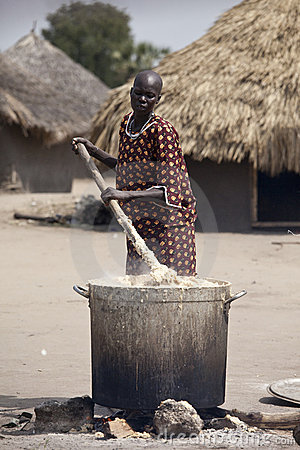Woman cooking cassava, Bor Sudan Editorial Stock Image