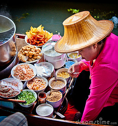 Woman cooking food in bangkok floating market Editorial Image