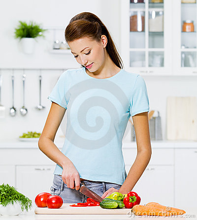 Free Woman Cooking Healthy Food Stock Images - 19806544