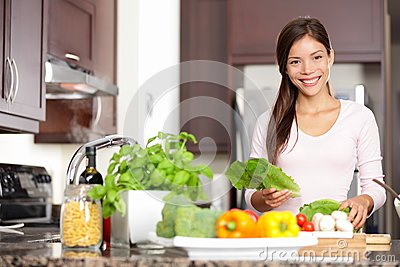 Woman cooking in new kitchen