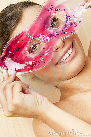 Woman with cooling facial mask
