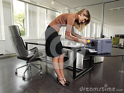Woman with copy machine tyu