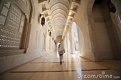 Woman in corridor inside Grand Mosque in Oman