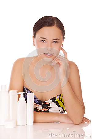 Woman with cosmetics for skincare