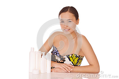 Woman with cosmetics for skincare and bodycare
