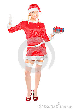 Woman in costume holding a gift and giving a thumb