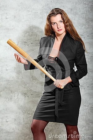 Woman in costume pose, hold bat