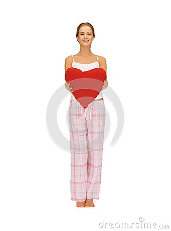Woman in cotton pajamas with big heart