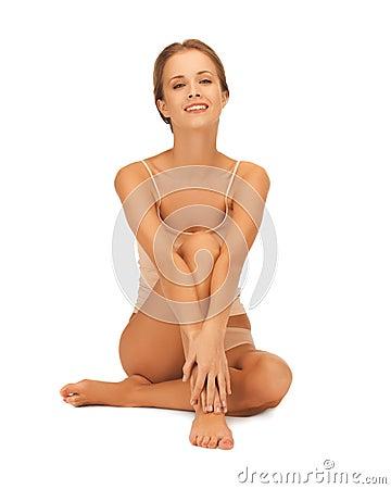 Woman in cotton underwear touching her legs