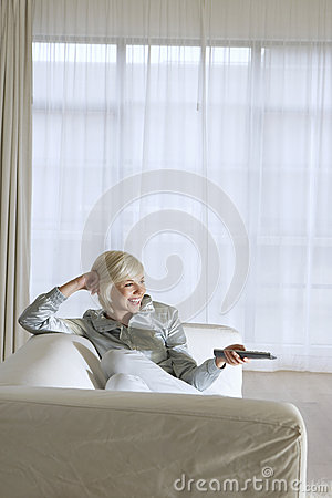 Woman On Couch Watching TV