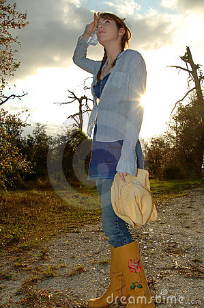 Woman in country with setting sun
