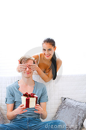 Woman cover eyes to waiting present boyfriend