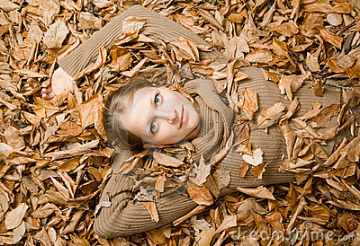 Woman covered with Autumn Leaves