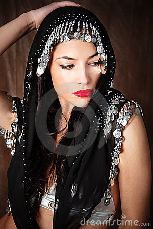 Woman covered with black scarf