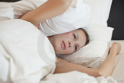 Woman covered with pillow