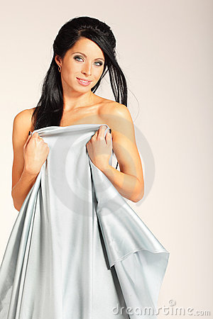Woman is covered with silver cloth