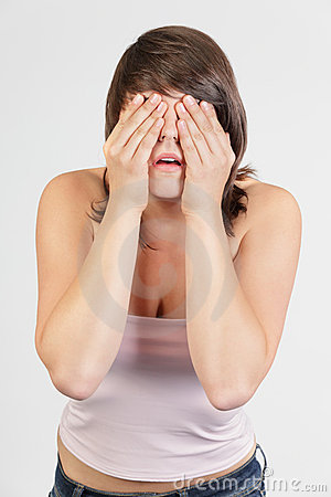 Woman covering face in denial