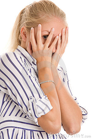 Woman covering face with hands Stock Photo