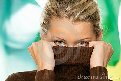 Woman covering face with turtleneck