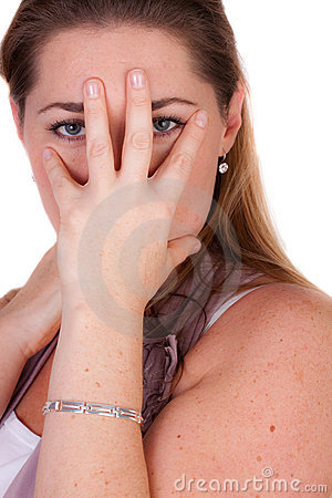 Woman is covering her face