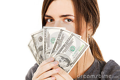Woman covering her face with dollar bills
