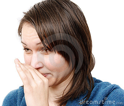 Woman covering her nose