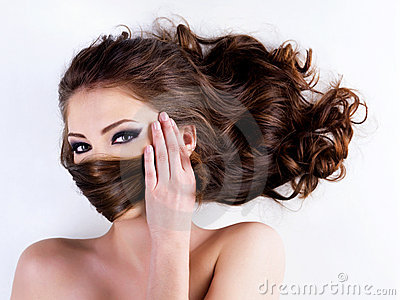 Woman covers the face by  hairs