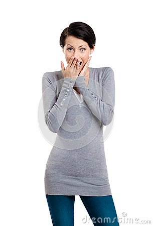 Woman covers her mouth with hand