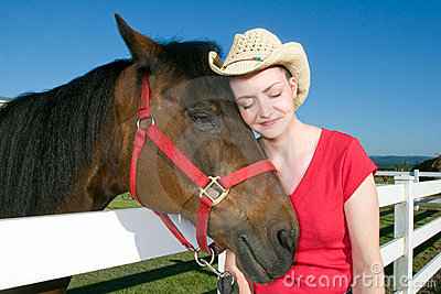 Woman in Cowboy Hat With Horse - Horizontal
