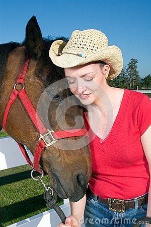 Woman in Cowboy Hat With Horse - Vertical