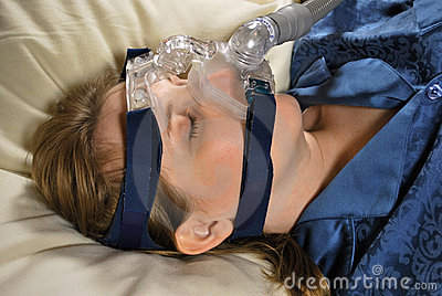 Woman with CPAP Mask