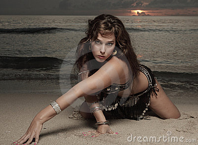 Woman crawling on the sand