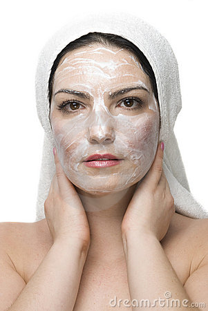 Woman with cream mask at daily spa