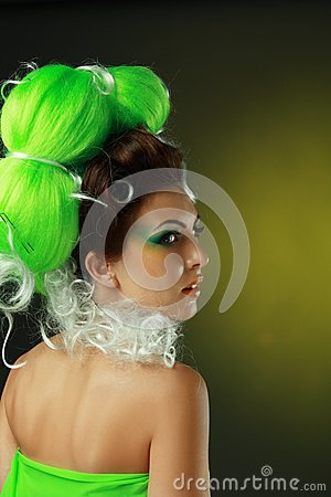 Woman with creative green hairstyle